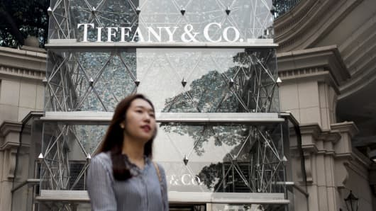 A pedestrian walks past a Tiffany & Co. store on Canton Road in the Tsim Sha Tsui area of Hong Kong.