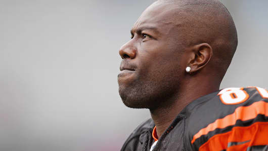 Terrell Owens, when he was with the Cincinnati Bengals, looks on during a game against the Carolina Panthers in Charlotte, N.C., in 2010.