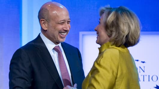 Lloyd Blankfein, CEO of Goldman Sachs, greets Hillary Clinton during the 2014 Clinton Global Initiative in New York.