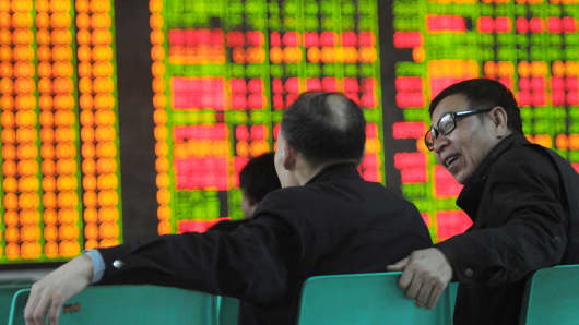 Investors observe stock market at a stock exchange corporation on April 17, 2015 in Jiujiang, Jiangxi province of China.