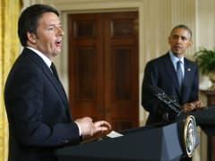 President Barack Obama (R) istens to Italian Prime Minister Matteo Renzi