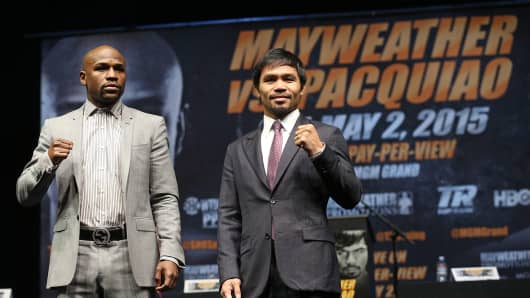 Floyd Mayweather Jr. (left) and Manny Pacquiao pose at the end of a press conference on March 11, 2015, in Los Angeles.
