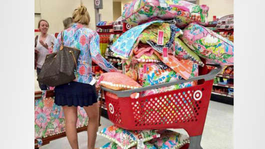 A shopper loads up her cart with Lilly Pulitzer for Target.