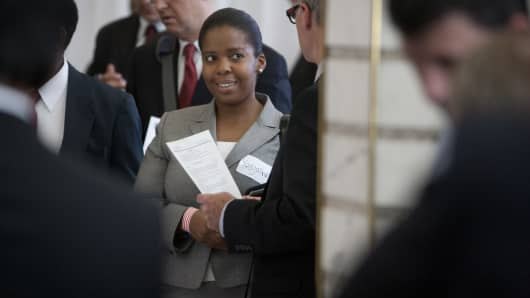 A job seeker speaks with an employer at the Veterans On Wall Street job fair in New York, U.S., on Thursday, June 21, 2012.