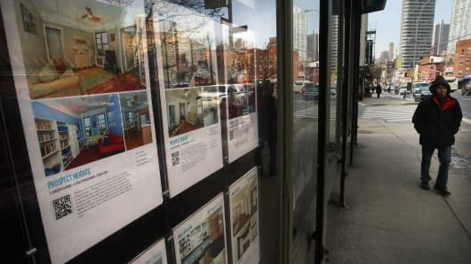 Real estate listings hang in a window in the Fort Greene neighborhood of New York City.