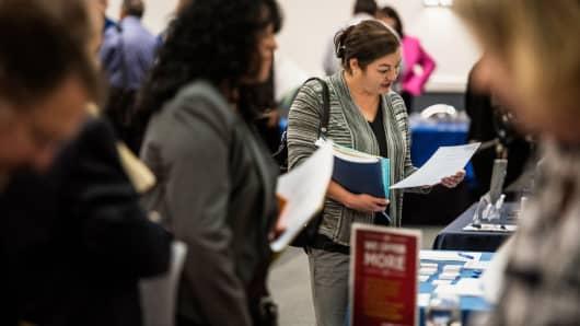 Job seekers speak with representatives at the Choice Career Fair in San Antonio, Texas.