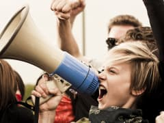 Protester using megaphone during de