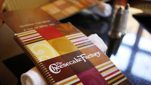 A menu sits on a table at a Cheesecake Factory restaurant in Louisville, Ky.