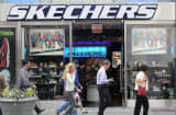 Pedestrians walk by a Skechers stor