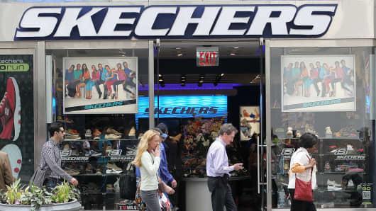Pedestrians walk by a Skechers store in New York.