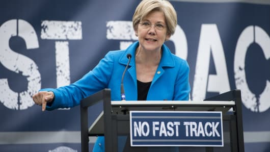 "Sen. Elizabeth Warren, D-Mass., speaks during a United Steelworkers rally in opposition to the proposed ""fast-track"" bill, or trade promotion authority, in Washington, April 15, 2015."