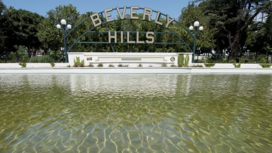 The Beverly Hills lily pond with the city's famous sign is seen during a severe drought in Beverly Hills, California on April 9, 2015.