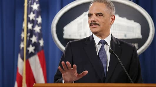 Attorney General Eric Holder speaks at the Robert F. Kennedy Department of Justice Building in Washington, March 4, 2015.