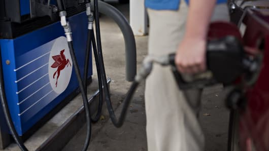 A customer fuels a vehicle at a Mobil gas station in Peoria, Illinois.