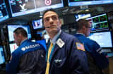 Investors watch earnings, Fed for direction