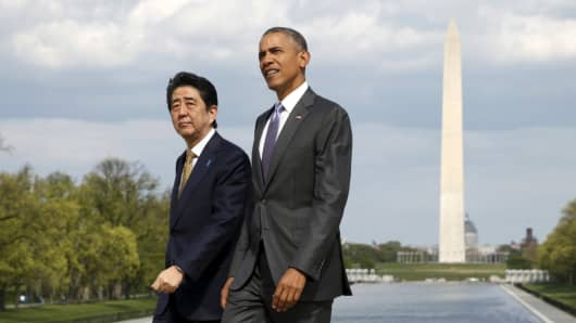 President Barack Obama and Japanese Prime Minister Shinzo Abe visit the Lincoln Memorial in Washington, with the Washington Monument in the background, on April 27, 2015. Abe is on a weeklong visit to the U.S.