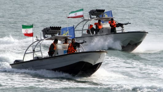 File photo of Iranian Revolutionary Guards driving speedboats.