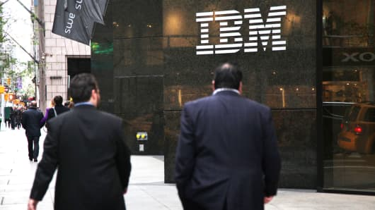 Pedestrians walk past the IBM building in New York.