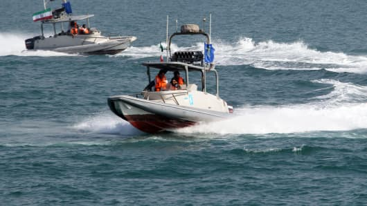 Iranian Revolutionary Guards drive speedboats during a ceremony to commemorate the 24th anniversary of the downing of Iran Air flight 655 by the US navy, at the port of Bandar Abbas on July 2, 2012.