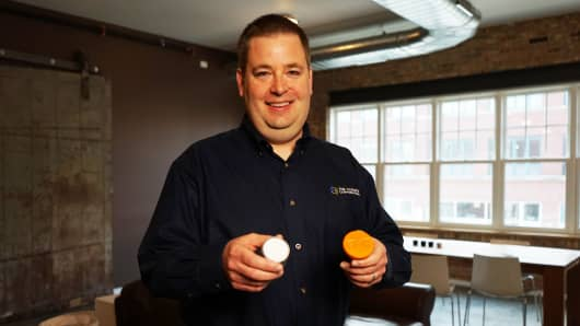 Corbett Kull, co-founder of 640 Labs, holding old and new versions of FieldView Drive.