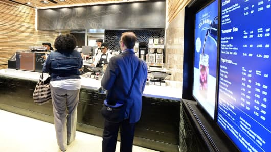 New Starbucks Express Format opens on Wall Street on April 30, 2015 in New York City.