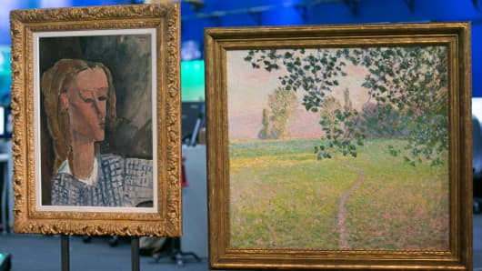 "Paintings owned by the late John Whitehead are going up for auction at Christie's in New York. On display here (L) is Amedeo Modigliani's ""Beatrice Hastings"" oil on canvas (estimated at $7 to $10million) , and Claude Monet's ""Paysage de Matin"" oil on canvas (estimated between $6 and $8million)."
