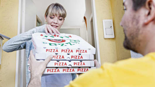 Woman accepting pizza delivery