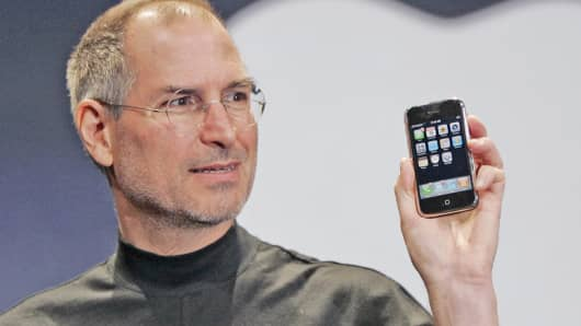 Steve Jobs held up the new iPhone during his keynote address at MacWorld Conference & Expo in San Francisco on Jan. 9, 2007.
