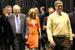 Warren Buffett and Bill Gates make their way to the Berkshire Hathaway Annual Shareholder's Meeting in Omaha, Nebraska on May 2, 2015.