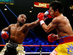 Floyd Mayweather Jr. throws a left at Manny Pacquiao during their welterweight unification championship bout on May 2, 2015