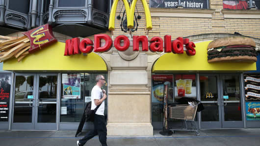 A pedestrian walks by a McDonald's restaurant in San Francisco.