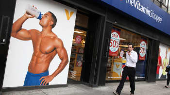 A pedestrian passes a location of The Vitamin Shoppe in New York