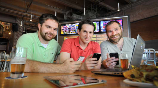 (Left to right) DraftKings co-founders Paul Liberman, Jason Robins and Matthew Kalish