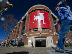 Pedestrians walk in front of the Zynga Inc. headquarters in San Francisco, California
