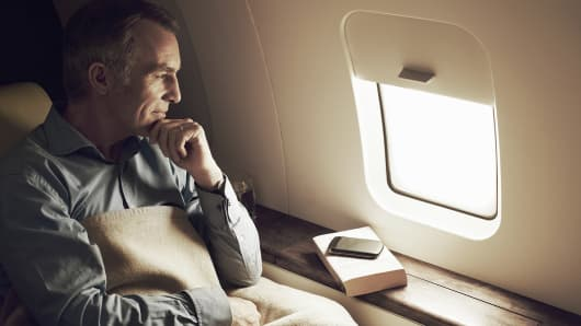 Businessman looking out of airplane window