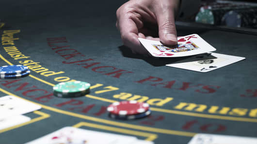 Croupier holding cards a blackjack table