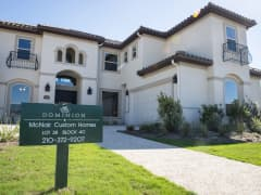 A new home for sale stands in the Andalucia neighborhood of The Dominion gated community in San Antonio, Texas