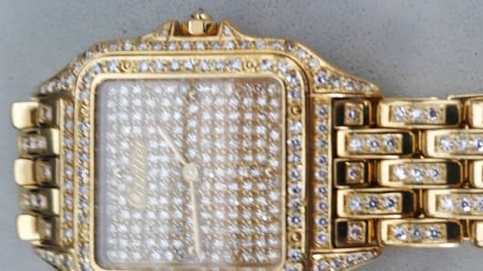 This May 5, 2015 photo provided by the Transportation Security Administration shows a diamond-encrusted Cartier watch that was left behind at a security checkpoint at Newark Liberty International Airport in Newark, N.J.
