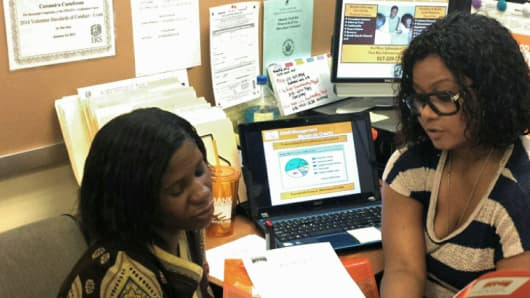 Ms. Wilson (L), with Rachel Perez, Food Bank For New York City's Financial Coach