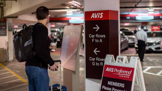 A customer waits for his car at the garage of Avis Budget Group at the San Francisco airport.