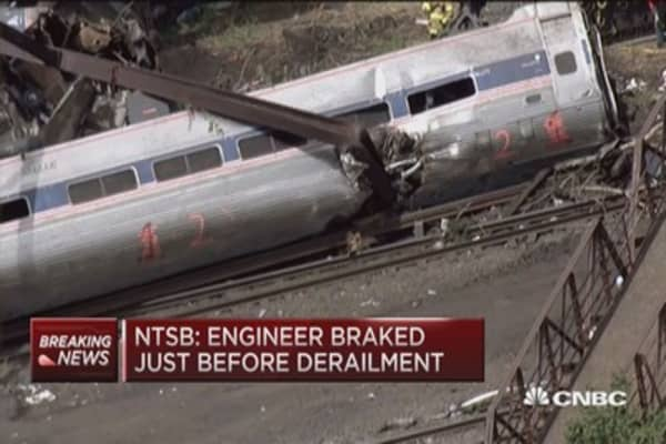 NTSB: Engineer hit brakes before derailment