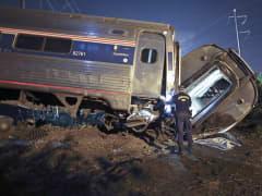 Emergency personnel at scene of Amtrak derailment