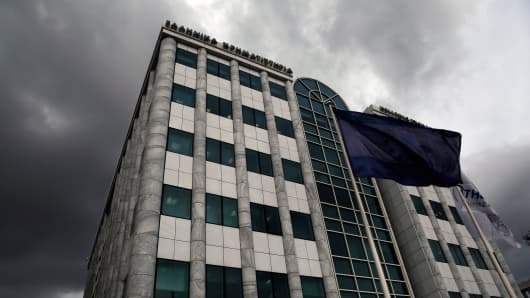 A European Union flag flies outside the Athens Stock Exchange.