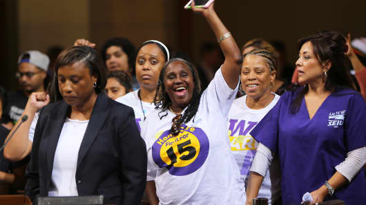 Workers demanding the Los Angeles City Council to vote to raise the minimum wage Tuesday, May 19, 2015, in Los Angeles.