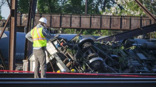 Rescue crews and investigators inspect the site of an Amtrak train derailment in Philadelphia on May 13, 2015.