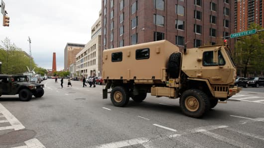 Military vehicles near City Hall, in Baltimore, May 1, 2015.
