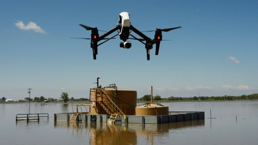 Industrial uses for drones are increasingly common. Here, a drone photographs flooding near oil operations in Kersey, Colorado, May 11, 2015.