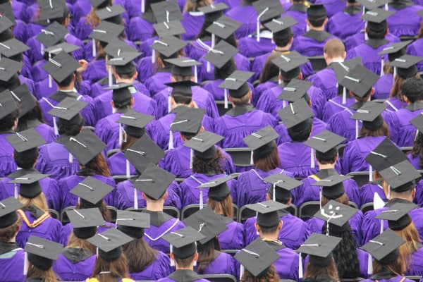 Robe- and mortar-bedecked students during the graduation at Northwestern University in Evanston, Ill.