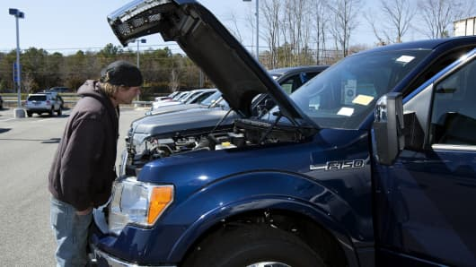 A customer looks at a Ford F-150 pickup truck at a CarMax dealership in Brandywine, Md.