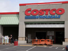 A customer leaves a Costco store in Richmond, California.
